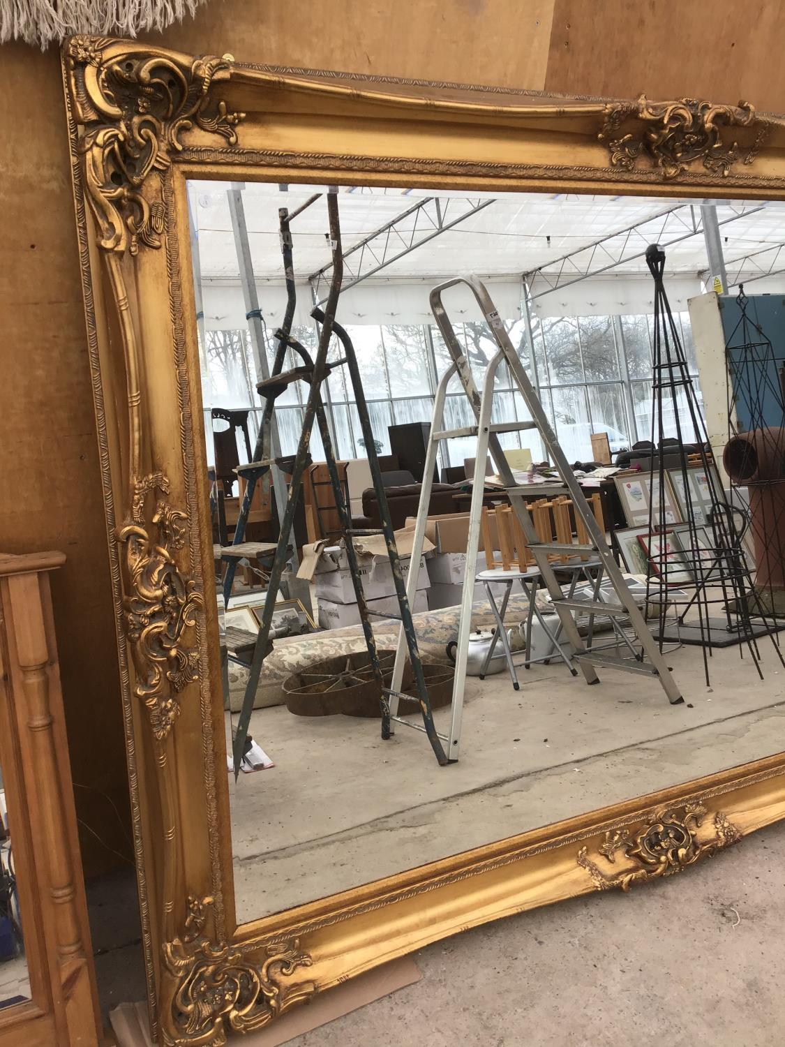 Lot 1 - A VERY LARGE ORNATE GILT FRAMED MIRROR 214CM X 154CM