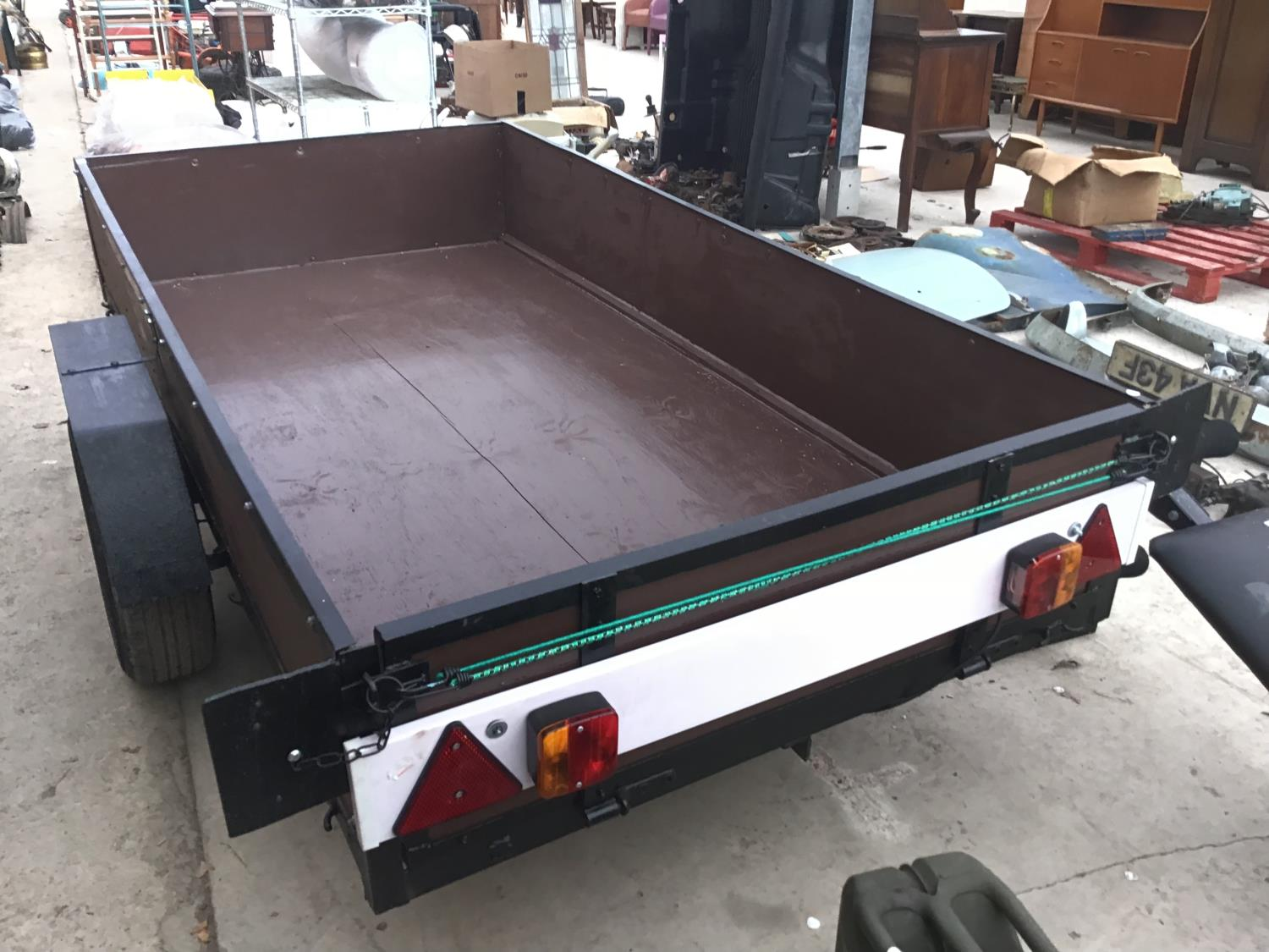Lot 44 - AN 8FT X 4FT WOODEN CAR TRAILER WITH TRAILER BOARD AND INTEGRATED BRAKING SYSTEM IN GOOD CONDITION