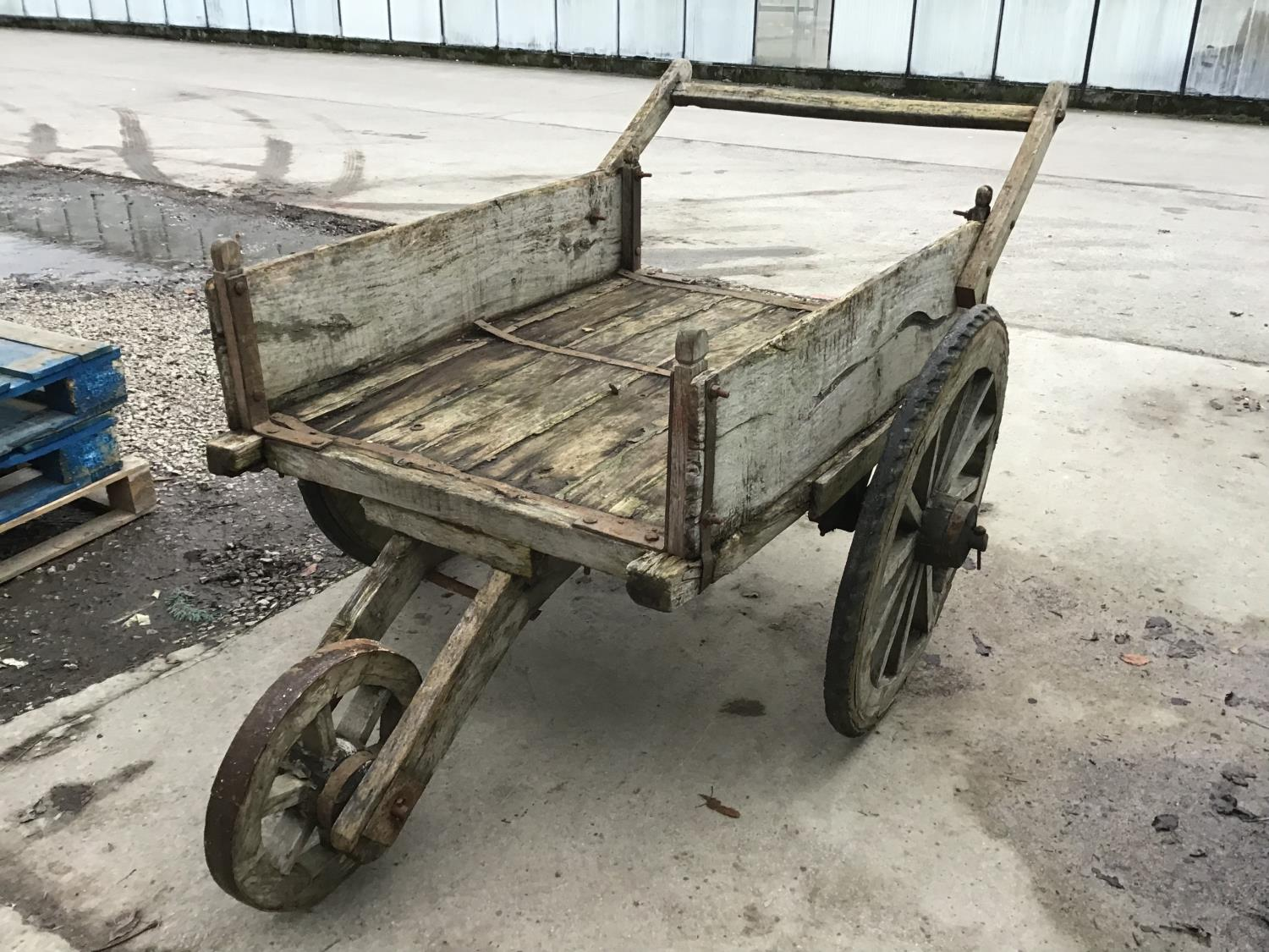 Lot 50A - A VINTAGE INDIAN WOODEN THREE WHEELED CART