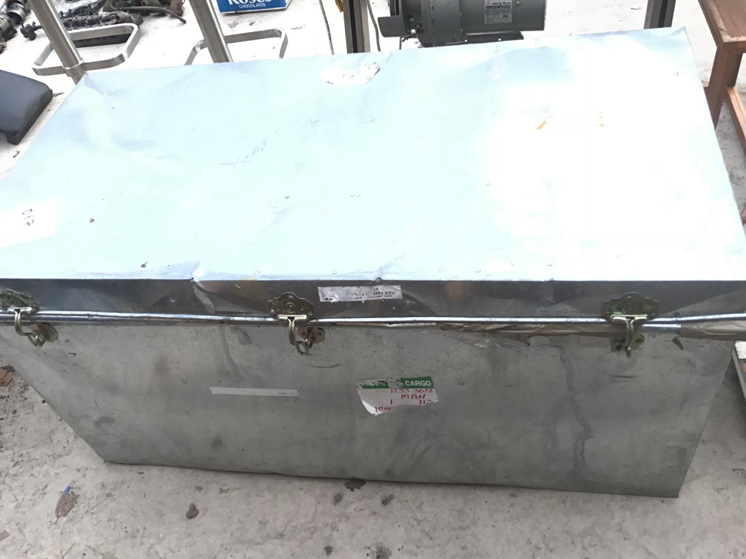 Lot 41 - A LARGE METAL CARGO CHEST WITH SIDE HANDLES