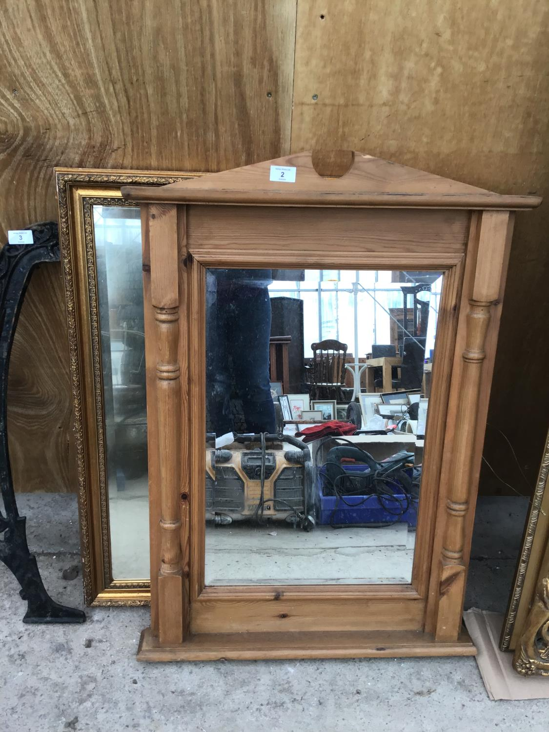 Lot 2 - A PINE FRAMED MIRROR WITH COLUMN SIDES AND AN ORNATE GILT FRAMED MIRROR