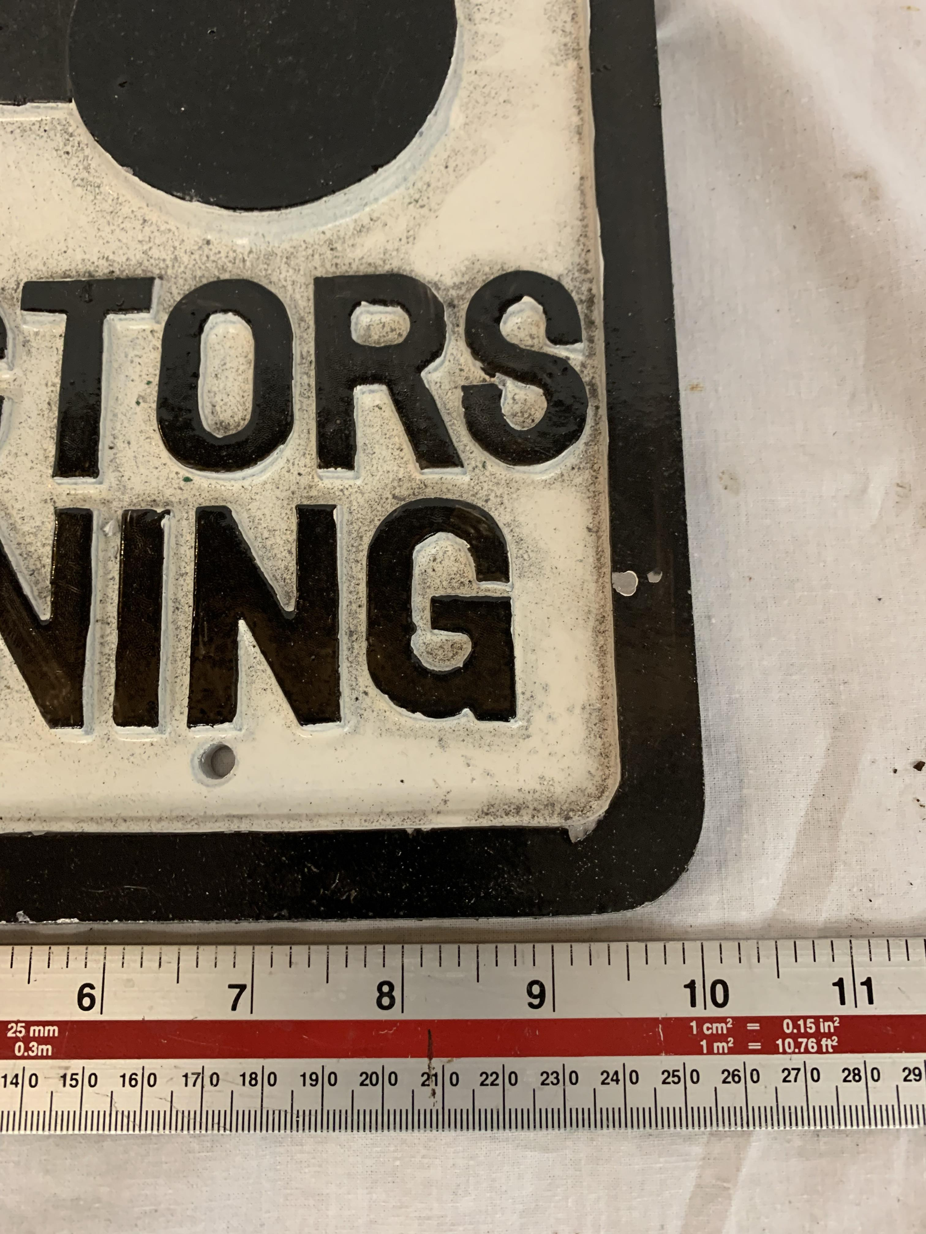 Lot 27 - A CAST TRACTORS TURNING SIGN 10 X 10 INCHES