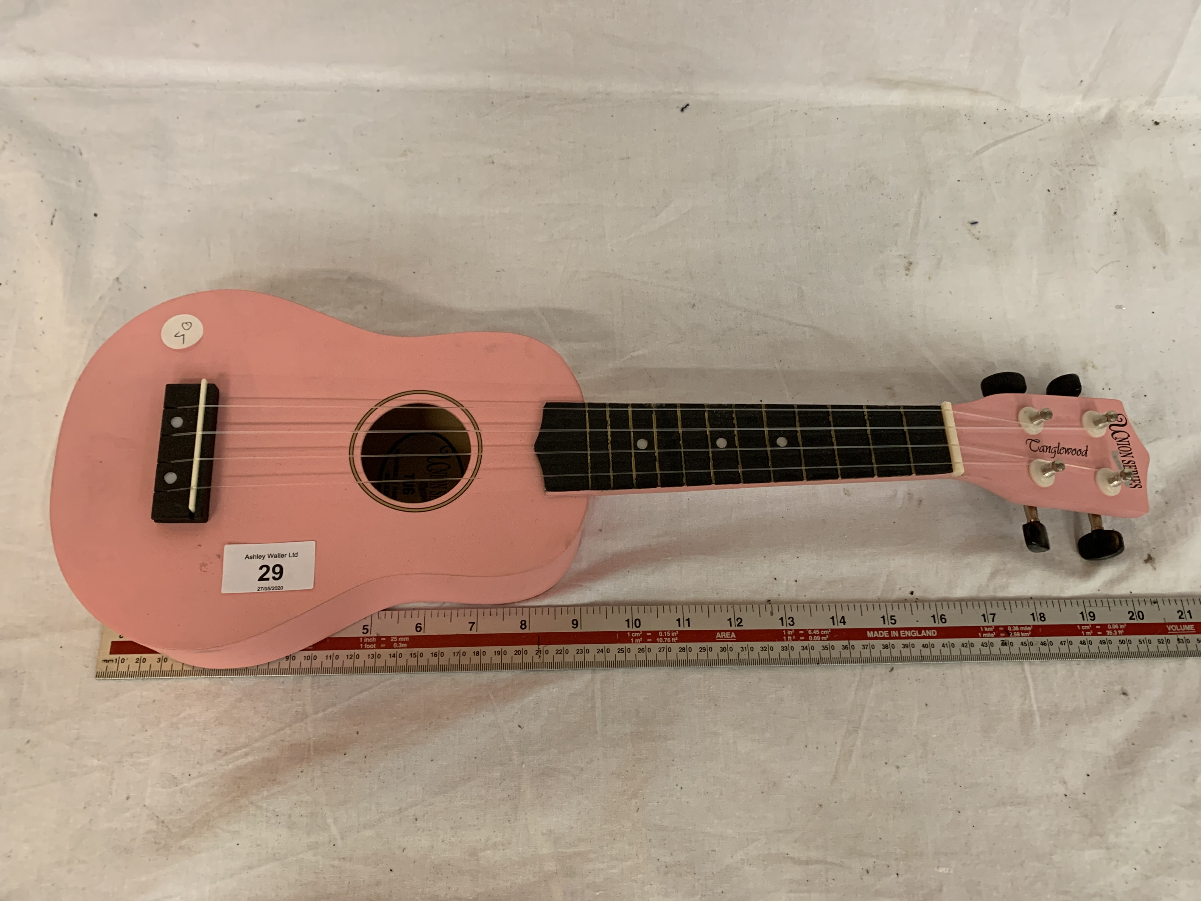 Lot 29 - A CHILDS PINK UNION SERIES TANGLEWOOD GUITAR