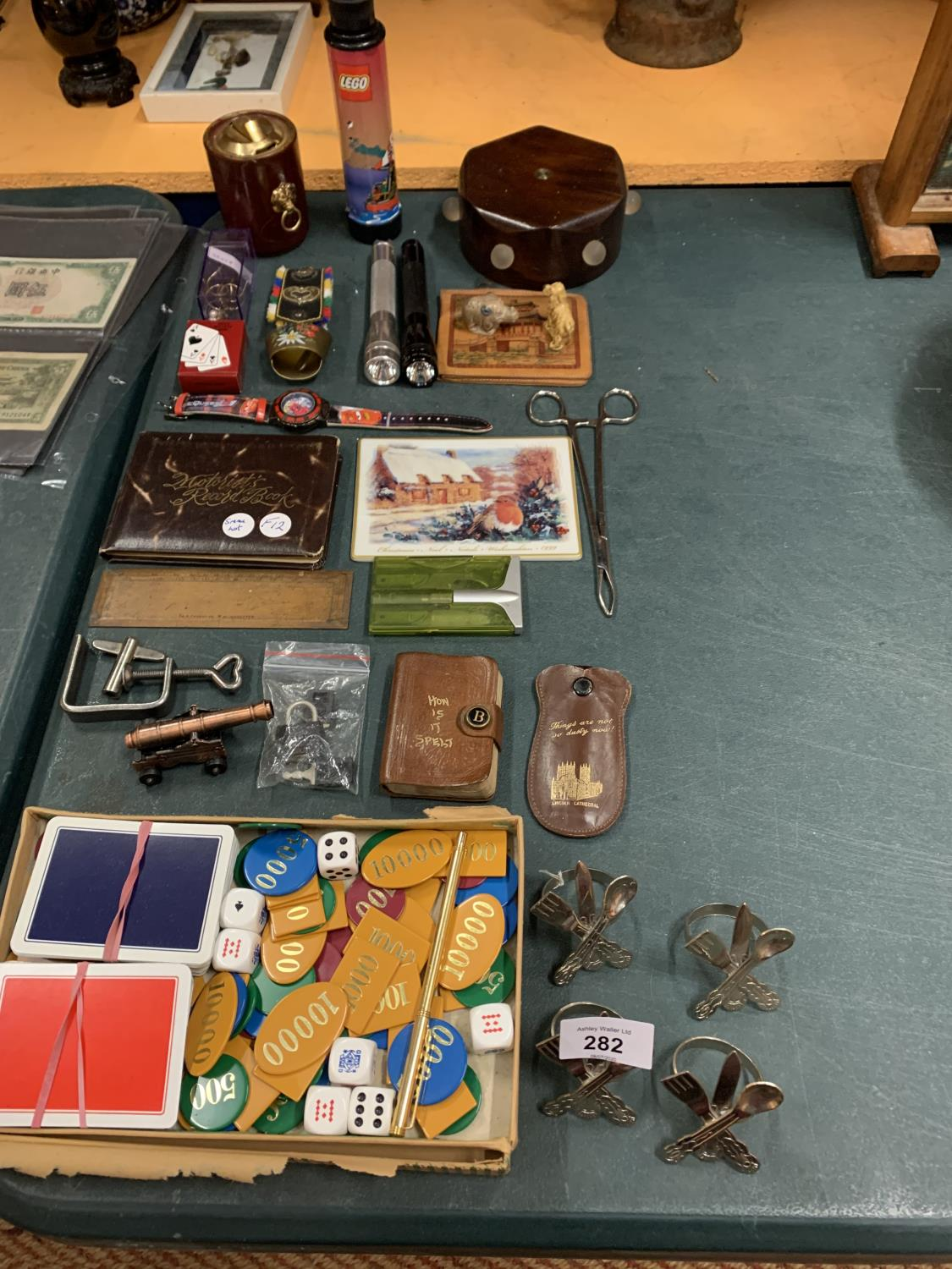Lot 282 - VARIOUS ITEMS TO INCLUDE NAPKIN RINGS, WATCH, COW BELL, BULL WORKER ETC