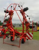 A 2013 KUHN GF6502 6 TURRET TEDDING MACHINE WITH INSTRUCTION BOOK/MANUAL