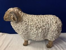 A LARGE RESIN RAM ORNAMENT