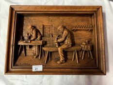 A SIGNED WOODEN CARVED PICTURE DEPICTING CARPENTERS AT WORK