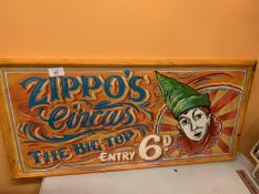 A HANDPAINTED WOODEN SIGN 'ZIPPO'S CIRCUS'