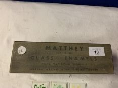 A VINTAGE BOX CONTAINING MATTHEY GLASS ENAMEL SAMPLES