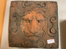 A TERRACOTTA LION TILE PLAQUE