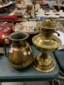 A LARGE BRASS JUG AND A BRASS OIL LAMP BASE