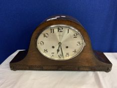 A LARGE WOODEN NAPOLEON'S HAT MANTEL CLOCK