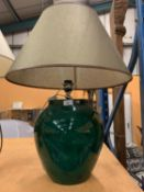 A VERY LARGE MODERN BOTTLE GREEN TABLE LAMP TO INCLUDE AN OLIVE GREEN TRIMMED SHADE