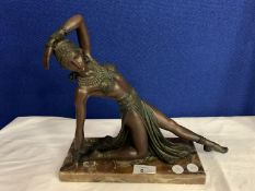 A SPELTER FEMALE FIGURINE IN THE ART DECO STYLE ON A MARBLE BASE (BASE A/F)
