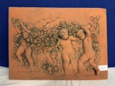 A TERRACOTTA CHERUBS TILE PLAQUE