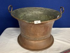 A COPPER TWIN HANDLED VINTAGE FOOT BATH