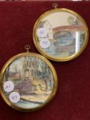 A PAIR OF CIRCULAR FRAMED SIGNED WATER COLOUR WALL PLAQUES
