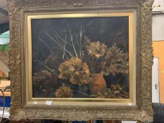 A GILT FRAMED OIL ON BOARD OF FLOWERS IN A VASE 48CM X 57CM