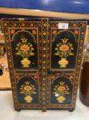 A MINIATURE DECORATIVE WARDROBE FOR THE STORAGE OF JEWELLERY ETC. TO INCLUDE NINE DRAWERS AND