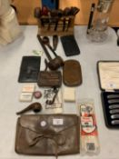 AN ASSORTMENT OF PIPE SMOKING ITEMS TO INCLUDE LEATHER TOBACCO POUCHES AND A PIPE STAND