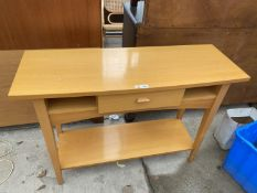 A BEECH SIDE TABLE WITH SINGLE DRAWER AND LOWER SHELF