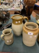 TWO LARGE BROWN AND GREY STONE WARE POTS AND ONE SMALLER GREY JUG