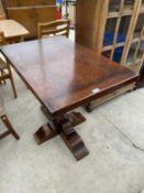 A RECTANGULAR OAK SIDE TABLE ON HEAVY PEDESTAL SUPPORT