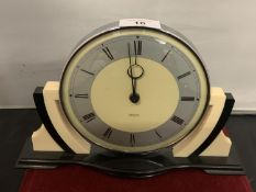 A VINTAGE BLACK AND CREAM 'SMITHS' MANTEL CLOCK