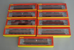 OO Gauge. 9 boxed Hornby BR unlined crimson Suburban Coaches of various types including five Gresley
