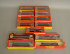 OO Gauge. 12 individually boxed items of Hornby Rolling Stock including Parcels, Passenger Brake and