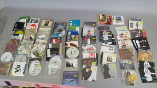 Closed record shop CDs including Warner music promo CDs, Island studios, Virgin, Columbia, etc