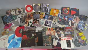 Ex record shop collection of 12 & 7 inch vinyl record picture discs plus other singles mainly new