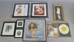 Closed record shop framed pictures including Ultimate Kylie CD DVD advert, Giving you up advertising