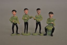 Four Beatles plastic figures, in sea green colour, each measuring about 6 cm. (4)
