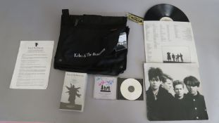 Echo & the Bunnymen Carlton International luggage bag promotional item including LP WX 108, cassette