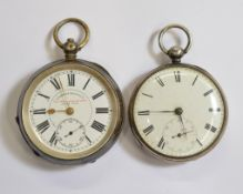 Two silver key-wind pocket watches, both with clean white enamel dials, both working