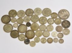 A bagged quantity of pre 20 silver coins to include an 1887 crown approx 60.7gms & pre 47 silver