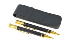 PARKER - A pair of Parker Duofold, a ball point & pencil, in a fitted leather sleeve