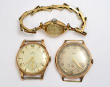 Two non-working 9ct H/M gents mechanical watch heads, 'Smiths & Trebex' together with a 9ct H/M