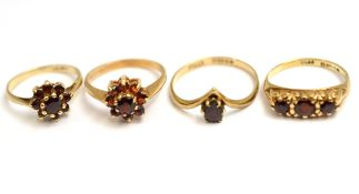 Four garnet set rings, three H/M 9ct, approx gross weight 6.5gms