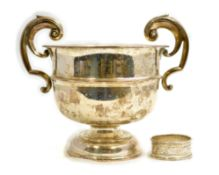 A silver two handled presentation bowl H/M Birmingham 1907 together with a single napkin ring,