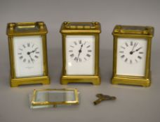 Three carriage clocks in various states of repair