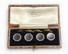 An early 20th century cased set of four dress studs, each stamped to reverse 9ct & pt
