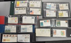 7 Folders containing a large number of First Day Covers