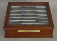 The complete US Presidential Coins Collection by Danbury Mint consisting of deluxe display case