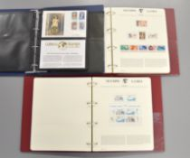 Two folders containing 1992 Olympic Games Masterfile stamp sets by Westminster together with an