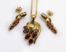 A 9ct H/M garnet set pendant & earring set, approx gross weight 9.5gms