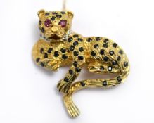 A 9ct H/M leopard brooch, with a diamond set collar, ruby eyes & sapphires, approx 37mm x 30mm,