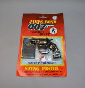James Bond 007. A carded  Coibel James Bond Secret Agent 'Sting Pistol', from 1985. The card