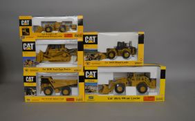 5 Caterpillar die-cast scale boxed models by Norscot, including; Wheel Loader, Off Highway Truck etc